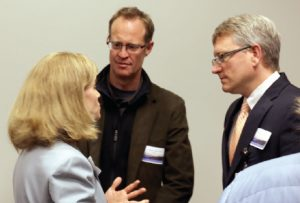 Dr. Julie Byerley speaks with Drs. Benjamin Gilmer and Blake Fagan after the program.