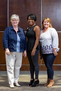 Angel Moore, center, Director of Practice Support at Eastern AHEC, pictured with two of her team members.